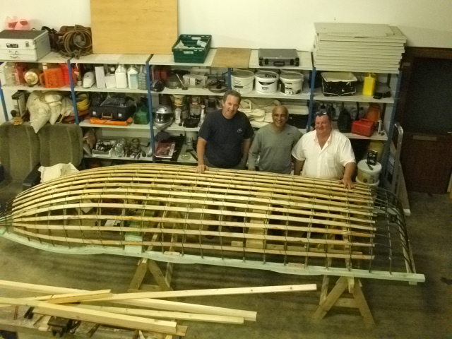 Edmund, BJ and Mick McCormick with the Curragh they are building